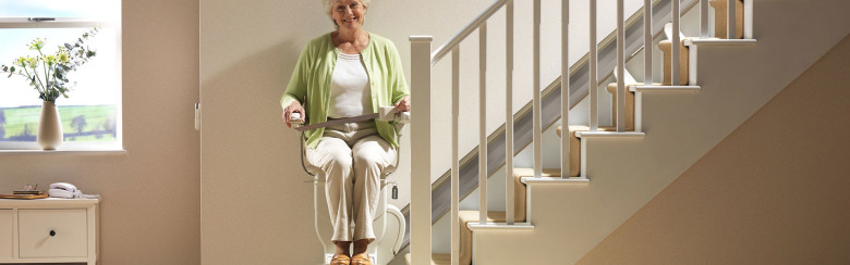 woman in stair chair with seat belt